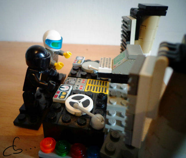 The Daft Punk mixing vinl records on a Lego turntable