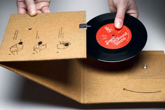 the folding cardboard phonograph and his vinyl record