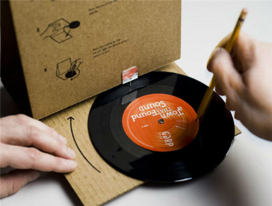 the folding cardboard phonograph playing the vinyl record