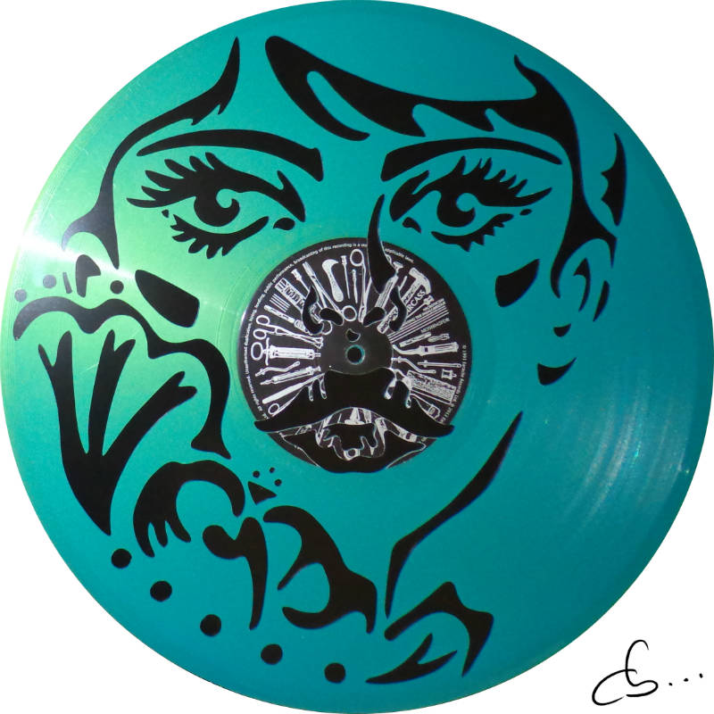 handmade craft art, Easter, a woman portrait carved from a turquoise blue vinyl record