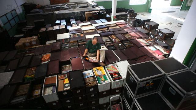 Zero Freitas sat on his record collection