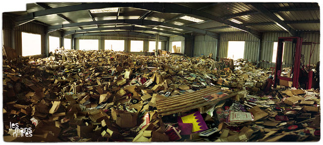 abandoned vinyl records in a warehouse