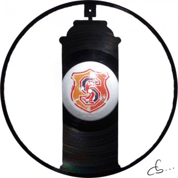 A graffiti bomb carved from a vinyl record