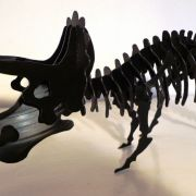 a sculpture of a dinosaur made out from vinyl records