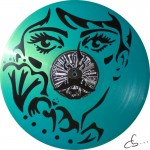 woman portrait carved from a vinyl record, design made by marion from the cloth shop anne et marion in paris