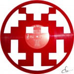 red monster from the video game space invaders on vinyl record