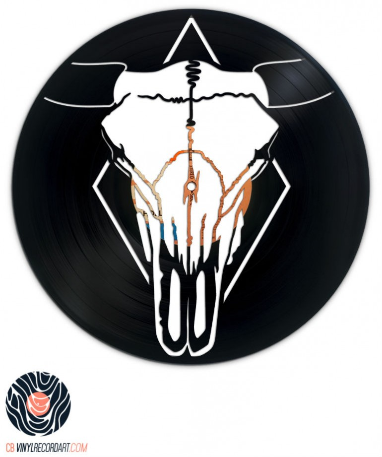 bull skull and sculpted artwork on vinyl record