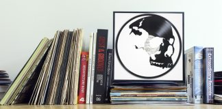 skull carved out from a vinyl record and displayed on a shelf