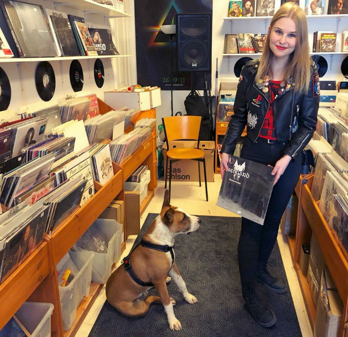 tanja and her dog in her record shop