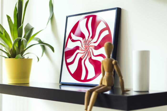 framed vinyl record on a shelf