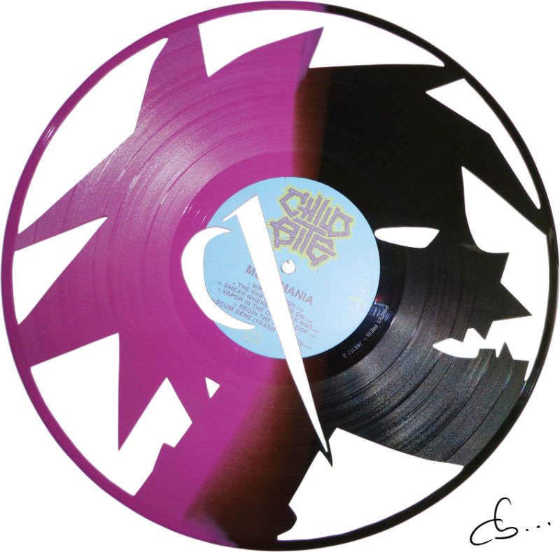 2D member of Gorillaz carved out from a purple and black vinyl record