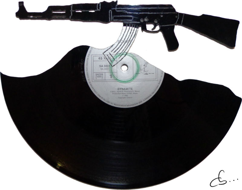 ak47 carved out of a vinyl record