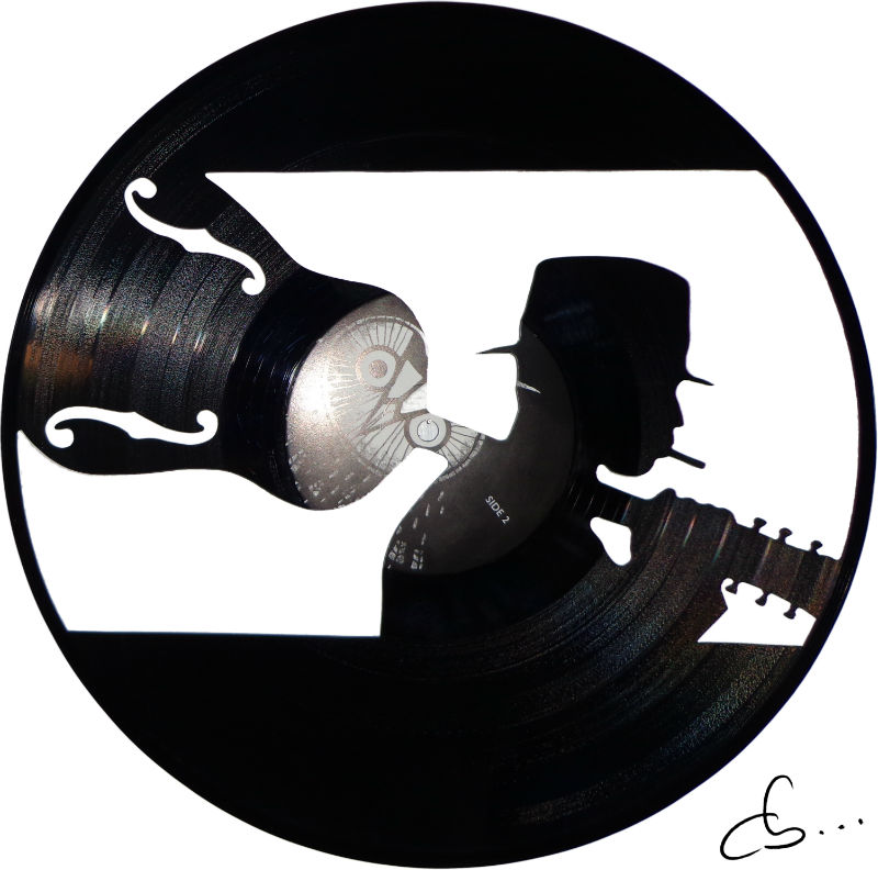 The Blues Man and his guitar on his back carved out from a vinyl record