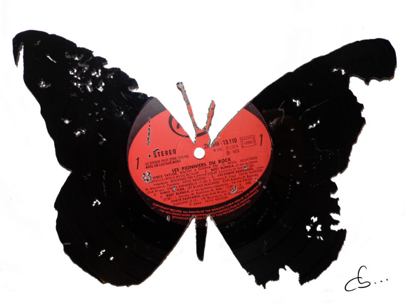Trashed Butterfly carved out of a vinyl record