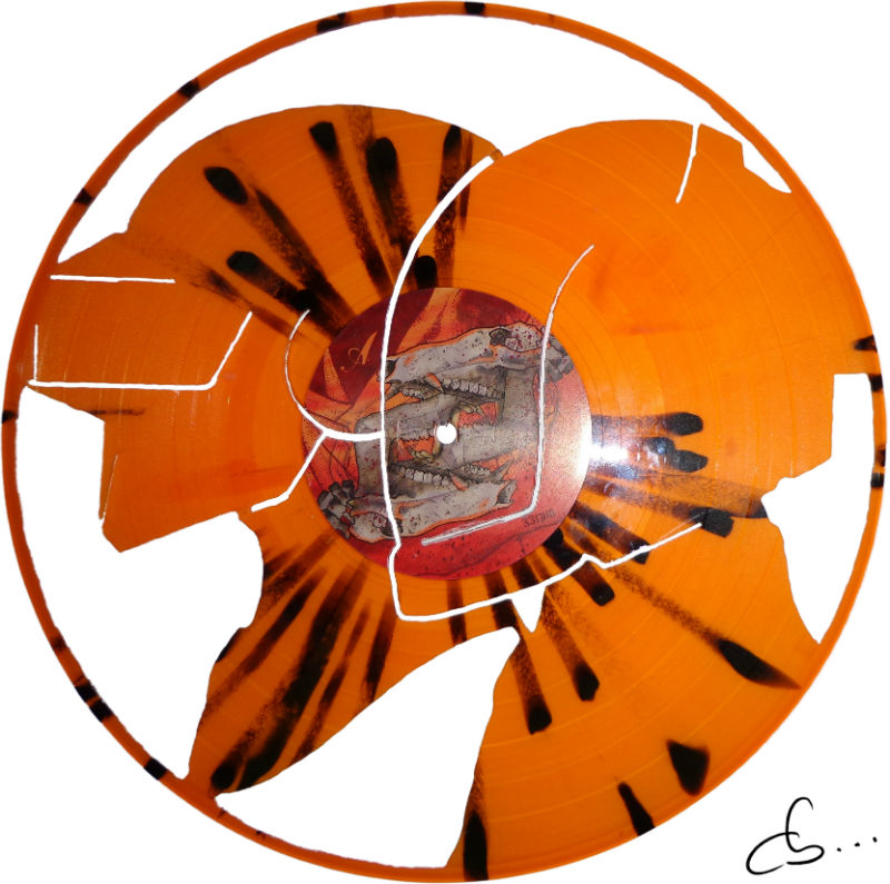 Daft Punk art logo carved out from an orange vinyl record