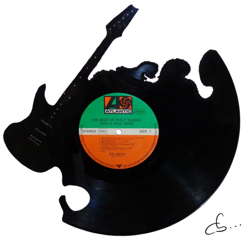 Guitar carved out from a vinyl record