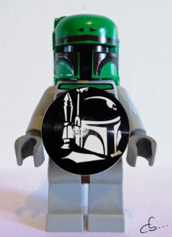 boba fett lego holds his portrait made from a vinyl record
