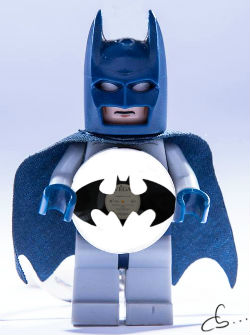 batman lego holds his portrait made from a vinyl record