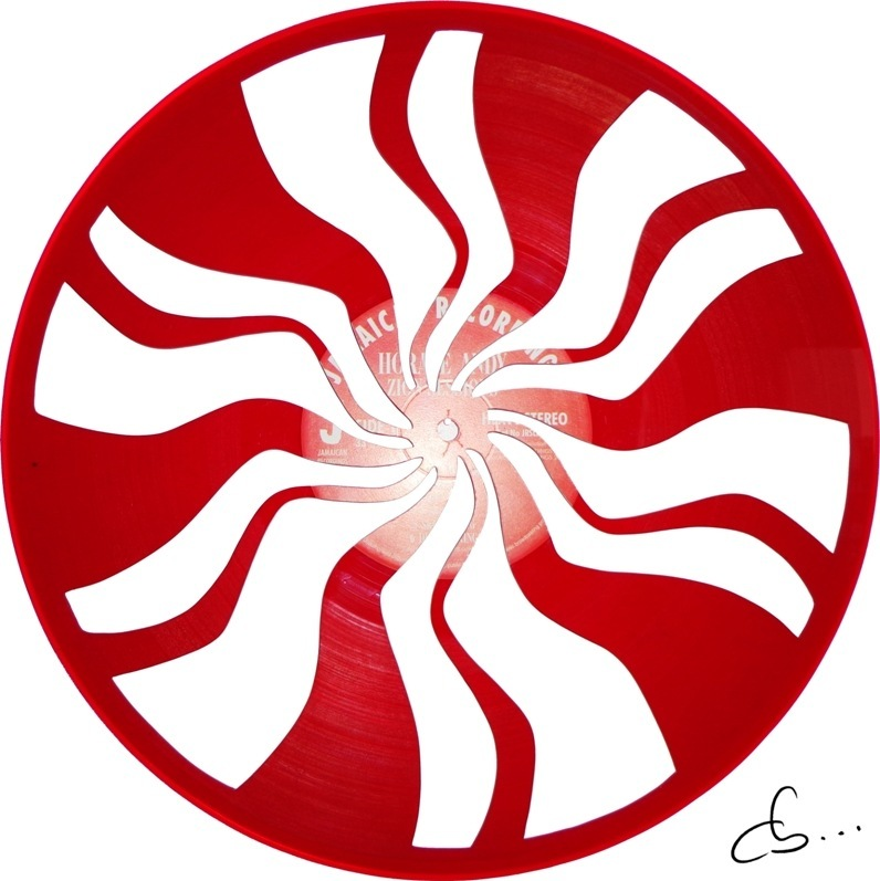 handmade art, the logo of the white stripes carved from a red vinyl record