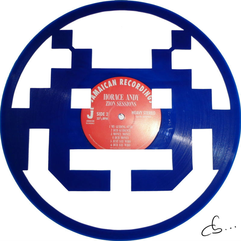 bleu monster from space invaders on vinyl record