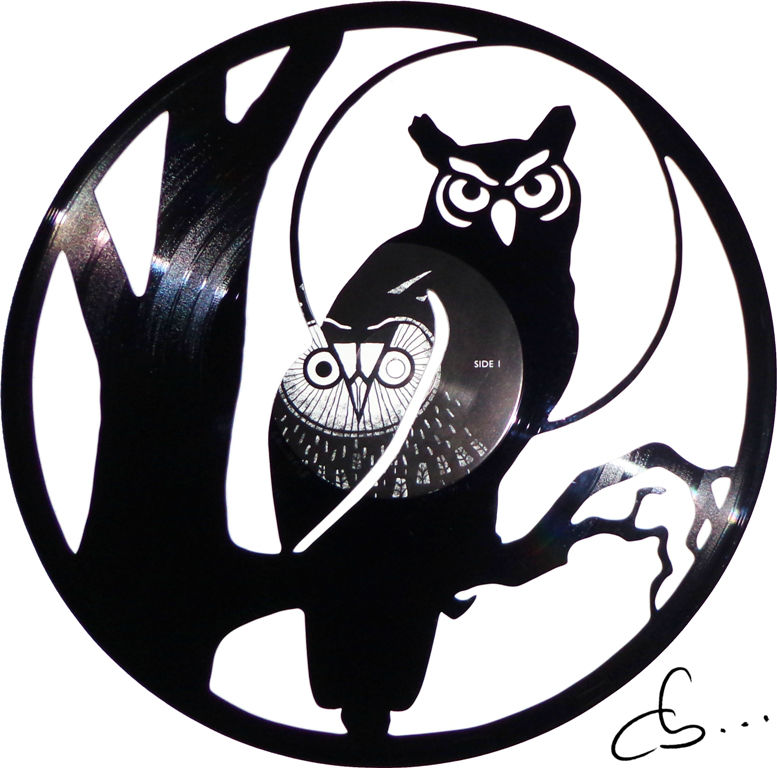 an owl on a branch, carved out from a vinyl record