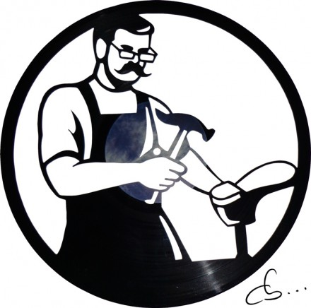 silhouette of a shoemaker carved out of a vinyl record