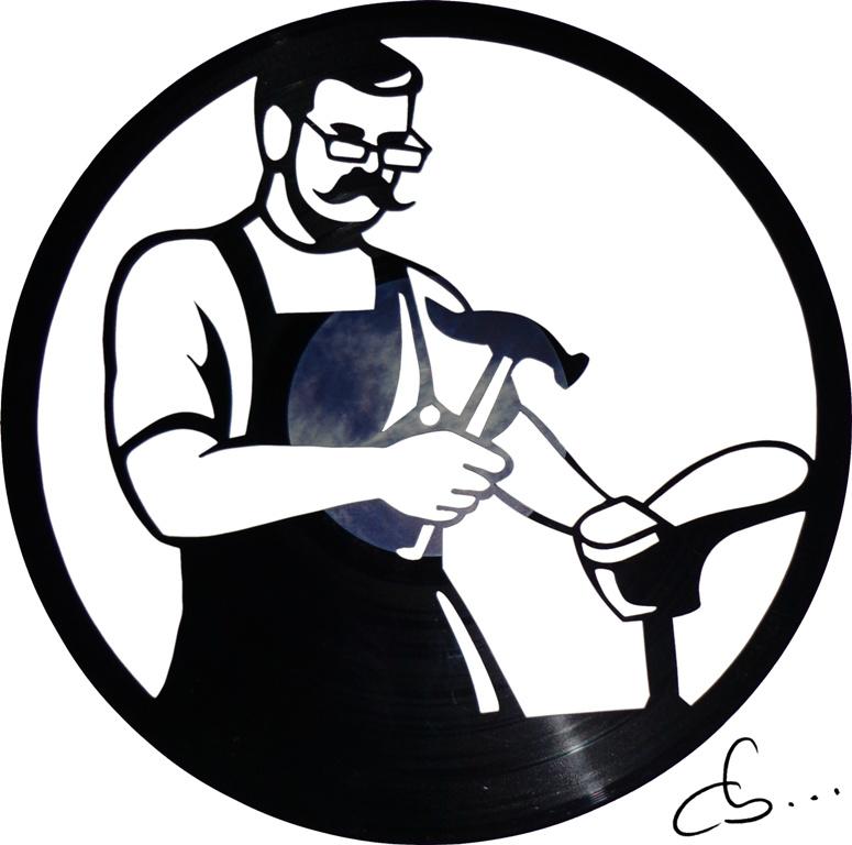 silhouette de cordonnier gravé sur un disque vinyle