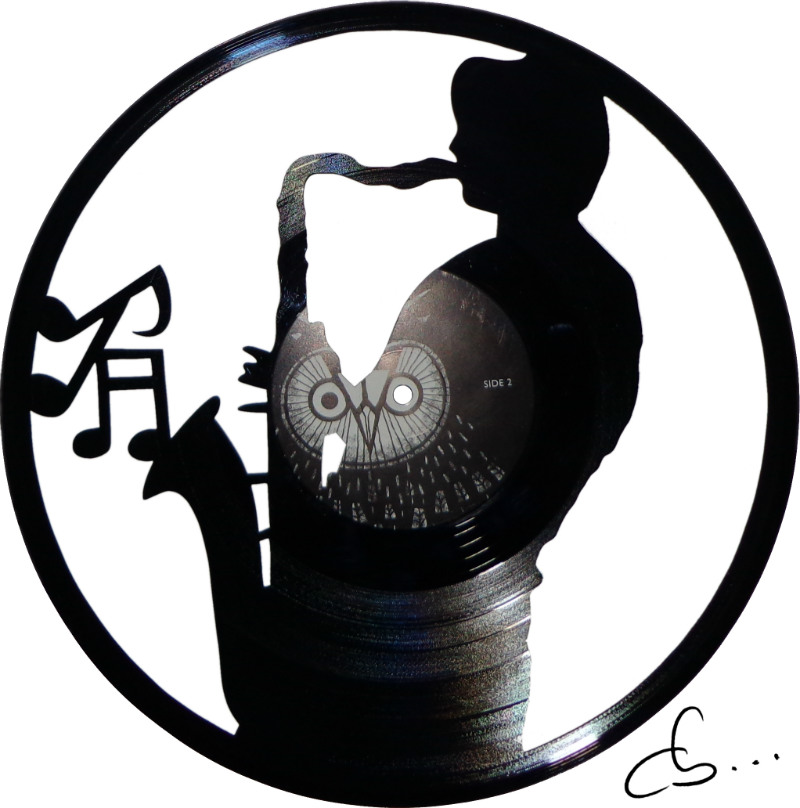 saxophonist playing a saxophone carved out of vinyl record